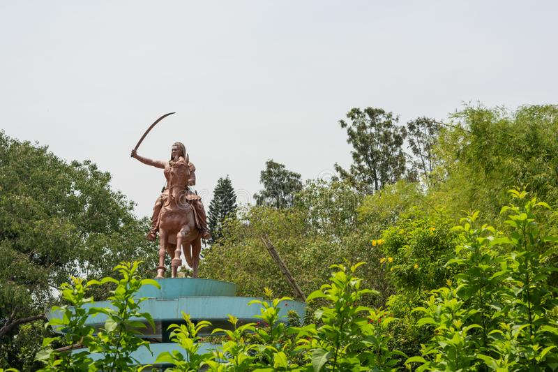 Bangalore, India, June 4, 2019 : Sculpture of queen Kittur Rani Chennamma on horse with sword at Bengaluru, Karnataka, India.  stock image