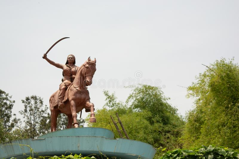 Bangalore, India, June 4, 2019 : Sculpture of queen Kittur Rani Chennamma on horse with sword at Bengaluru, Karnataka, India royalty free stock images