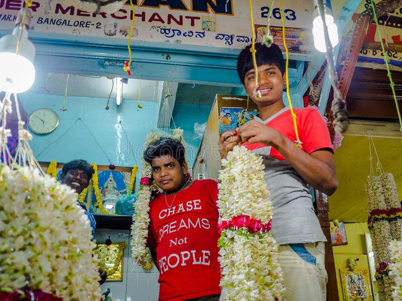BANGALORE, INDIA - June 06 2017: Unidentified guys as flower sellers at KR Market in Bangalore. in Bangalore, India royalty free stock image