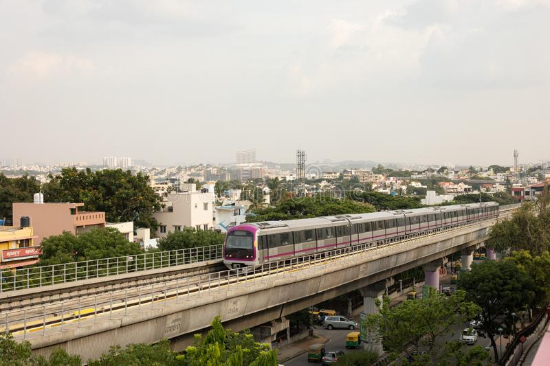 Bangalore, Karnataka India-June 01 2019 : Aerial View Bengaluru metro moving on the bridge near Vijaya Nagara, Bengaluru , India.  stock photography