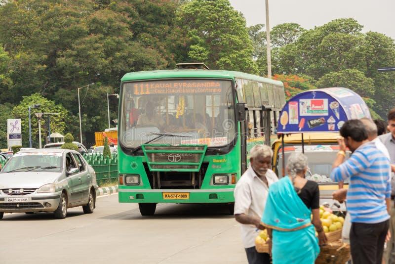Bangalore, Karnataka India-June 04 2019 : Bengaluru city Local BMTC bus with people near vidhana soudha, Bengaluru, India.  royalty free stock photos