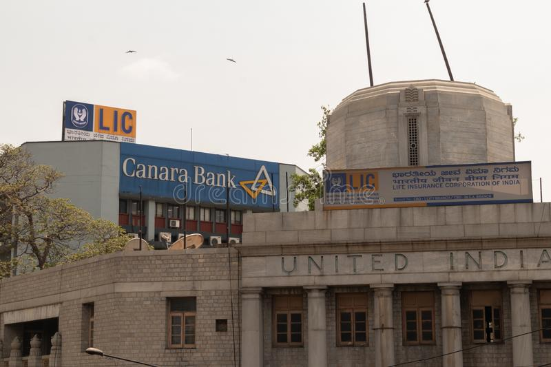 Bangalore, Karnataka India-June 04 2019 : LIC or life insurance corporation of India and Canara bank billboard on top the building. At bengaluru,India stock photo