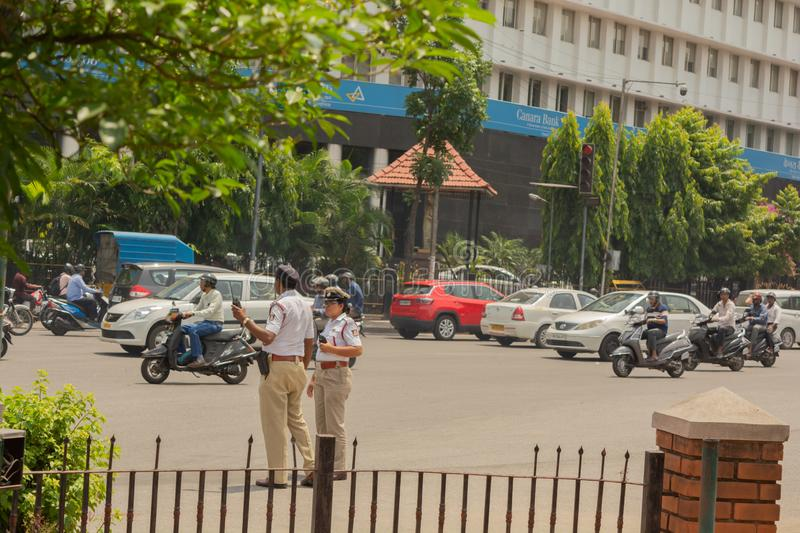 Bangalore, Karnataka India-June 04 2019 :Moving Traffic near town hall circle and City traffic police busy at work in Bengalore.  royalty free stock photo