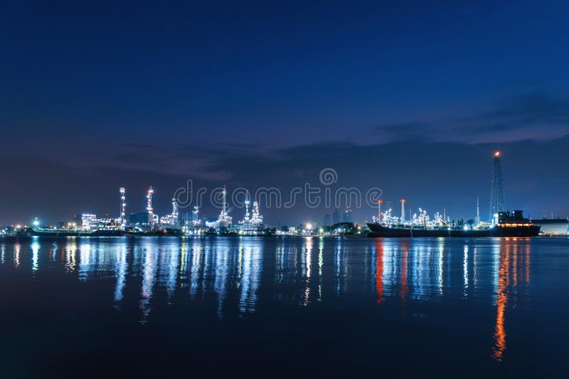 Bangchak Petroleum`s oil refinery at night in industrial enginee. Ring concept. Water reflection. Oil and gas industry. Urban city, Bangkok, Thailand stock photo