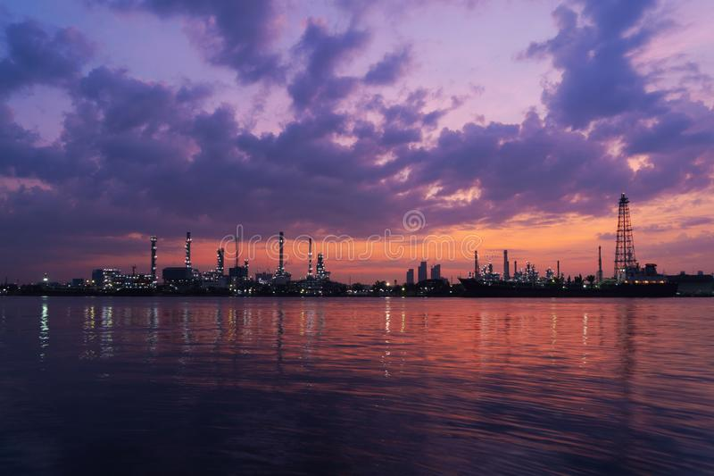 Bangchak Petroleum`s oil refinery at sunrise in industrial engin. Eering concept. Water reflection. Oil and gas industry. Urban city, Bangkok, Thailand royalty free stock photo