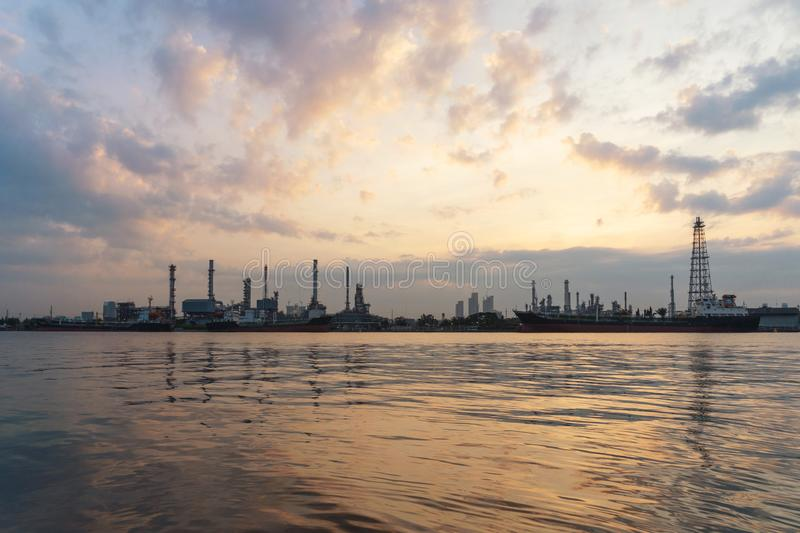 Bangchak Petroleum`s oil refinery at sunrise in industrial engin. Eering concept. Water reflection. Oil and gas industry. Urban city, Bangkok, Thailand stock image