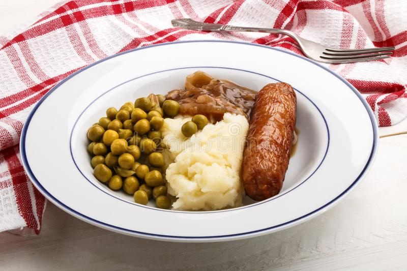 Banger and mash potato with cooked pea stock photo