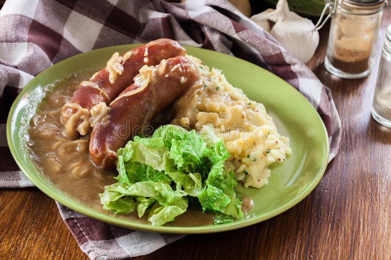Bangers and Mash. Baked sausage in onion gravy stock photo