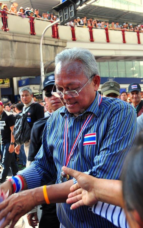 Bangko, Thailand: Suthep Thaugsuban, Leader of the PDRC. BANGKOK, THAILAND: Thais reach out to shake the hand of Suthep Thaugsuban, the leader of the People's stock image
