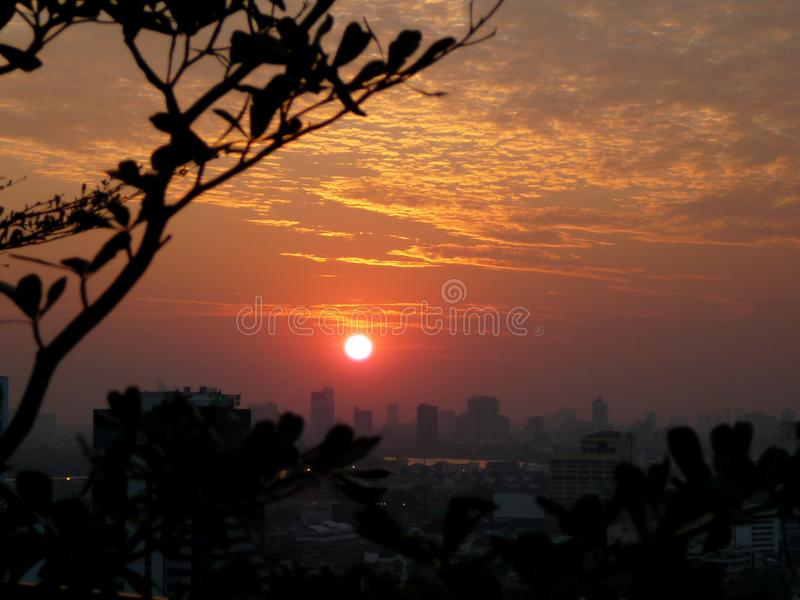 Bangkok Burning Bright Hot Sunset. Thailand has the most romantic sunsets on this planet and it has the ability to mesmerize one until it finally sets stock photos