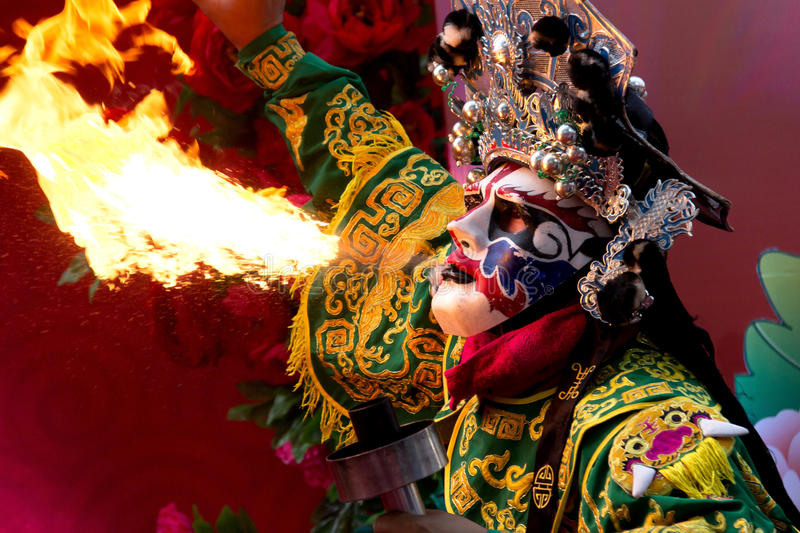 Bangkok Chinese New Year, Chinese Opera actor perform spitting fire in the traditional face-changing. royalty free stock photography