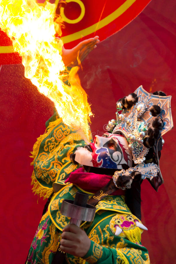 Bangkok Chinese New Year, Chinese Opera actor perform spitting fire in the traditional face-changing. Bangkok Chinese New Year, Chinese Opera actor perform stock images