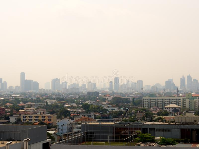Cityscape urban skyline in the mist or smog. Wide and High view image of Bangkok city in the smog. Bangkok City downtown cityscape urban skyline in the mist or stock image