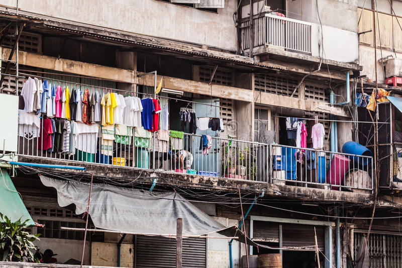 Bangkok city slum. Wooden slums on stilts on the riverside of Chao Praya River in Bangkok, Thailand royalty free stock photography