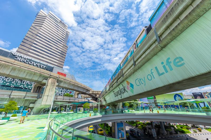 Bangkok city view of Siam Discovery and MBK Center point. Colorful and popular travel location green sky walk with tourist around the world. 13 September 2018 royalty free stock image