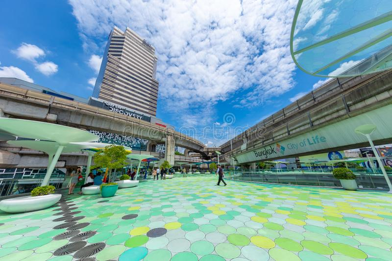 Bangkok city view of Siam Discovery and MBK Center point. Colorful and popular travel location green sky walk with tourist around the world. 13 September 2018 stock photos