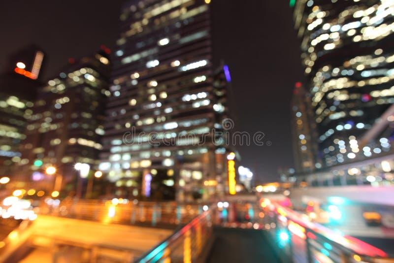 Bangkok cityscape på nattetid, suddig fotobokeh royaltyfria bilder