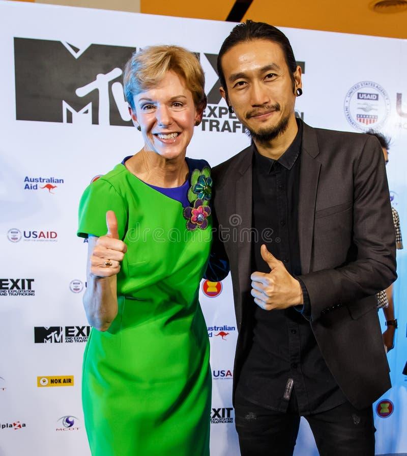 BANGKOK - FEBRUARY 19 2014: Toon (Athiwara Khongmalai) - Lead Si. Nger of Bodyslam with Krisie Kenney (US Ambassador) at MTV Exit Press Conference held in royalty free stock image