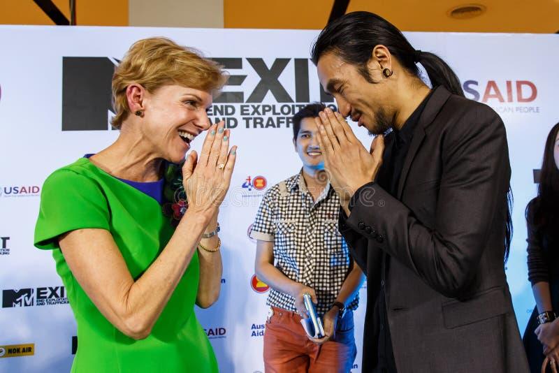 BANGKOK - FEBRUARY 19 2014: Toon (Athiwara Khongmalai) - Lead Si. Nger of Bodyslam with Krisie Kenney (US Ambassador) at MTV Exit Press Conference held in stock photography
