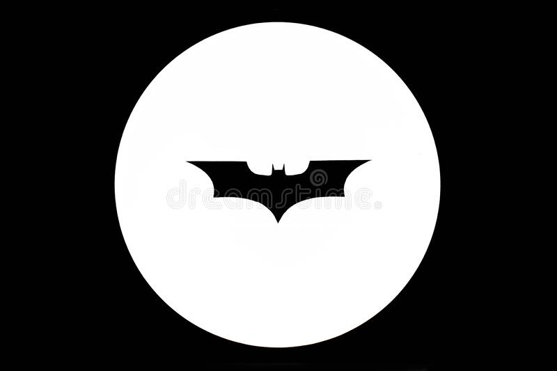 BANGKOK - JUNE 4, 2016 : Black paper cut as Batman logo and put on a spotlight, calling for help concept. Isolated Batman logo. Pr. Ocessed in black and white stock illustration