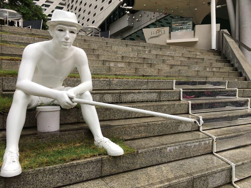 Fancy fisher sculpture by Fiesta Steppe hotel, Bangkok stock photos