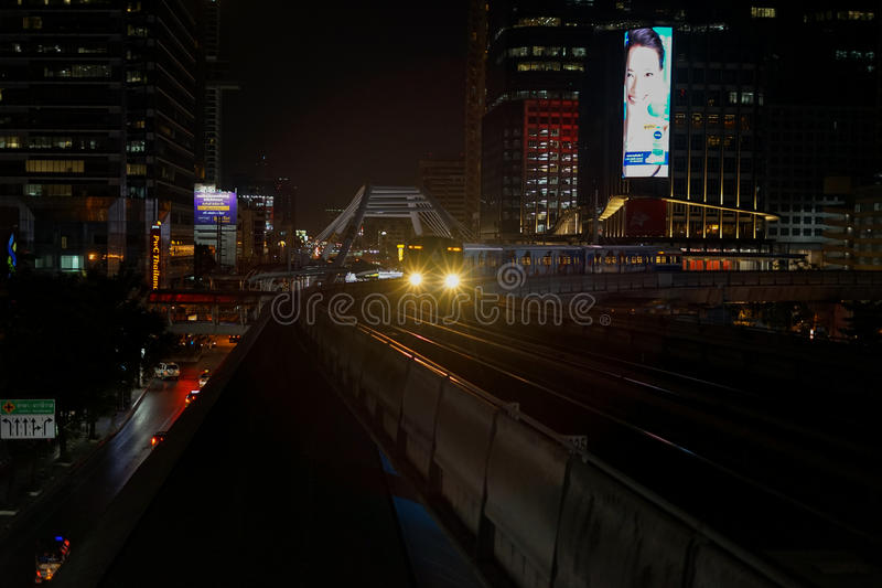 The Bangkok Mass Transit System BTS sky train arriving Chong Nonsi Station night time stock images