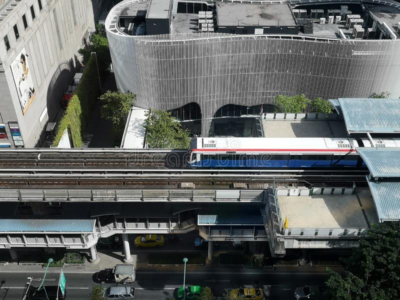 BANGKOK - October 31,2019: Birds eye view of a BTS Skytrain on elevated rails in Phloen Chit district,condominiums and hotels in b stock photo