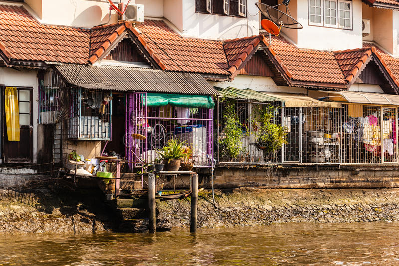 Bangkok riverside house. Wooden slums on stilts on the riverside of Chao Praya River in Bangkok, Thailand stock images