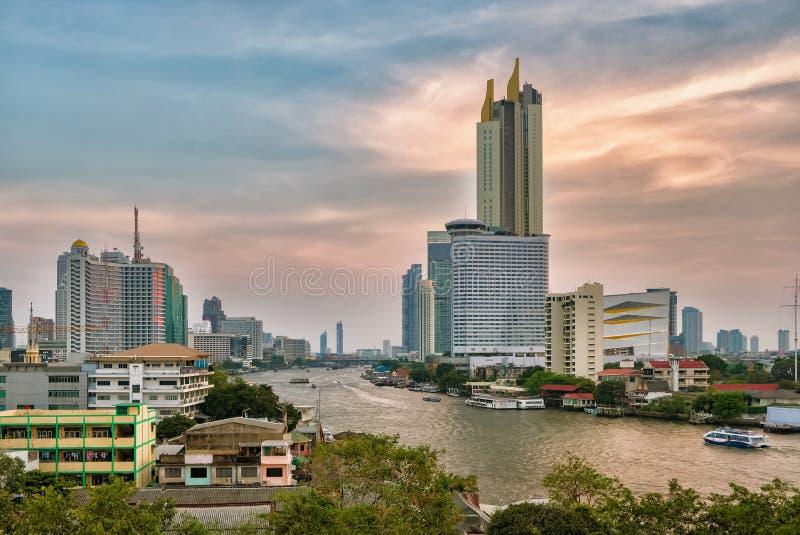Bangkok skyline and business skyscrapers at Chaopraya river at sunset stock photos