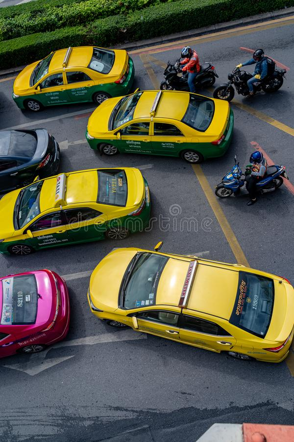 Bangkok Taxis & Motorbikes Clog Traffic. Taxis in Bangkok, Thailand must share the road with motorbikes, buses, cars and pickup trucks, plus the occasional stock photo