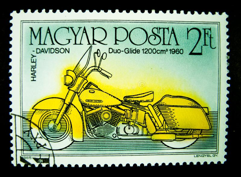 A stamp printed in Hungary shows an image of Harley Davidson duo glide 1960 on value at 2 Ft. stock photo