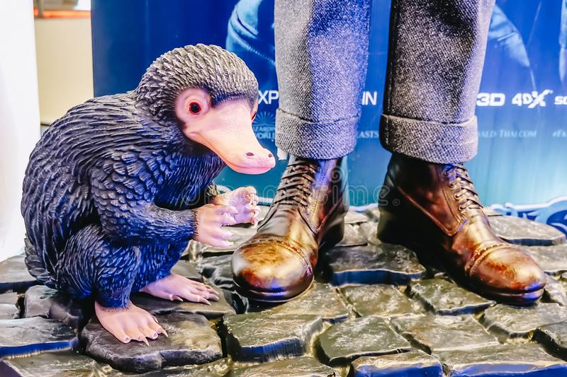 A Status of Niffler a creature with a long snout and a coat of black, fluffy fur from A Movie Fantastic Beasts 2 stock photos