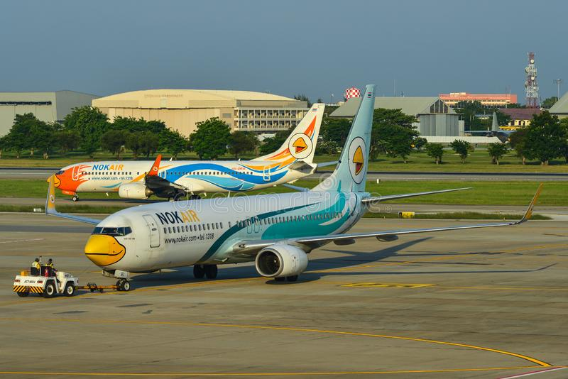 Airplane taxiing on runway of Bangkok Airport royalty free stock image