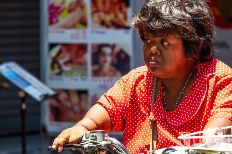 Woman on a motorbike Bangkok Thailand stock image