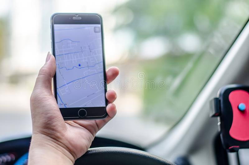 Man in the car and holding black mobile phone with map gps navigation royalty free stock photos
