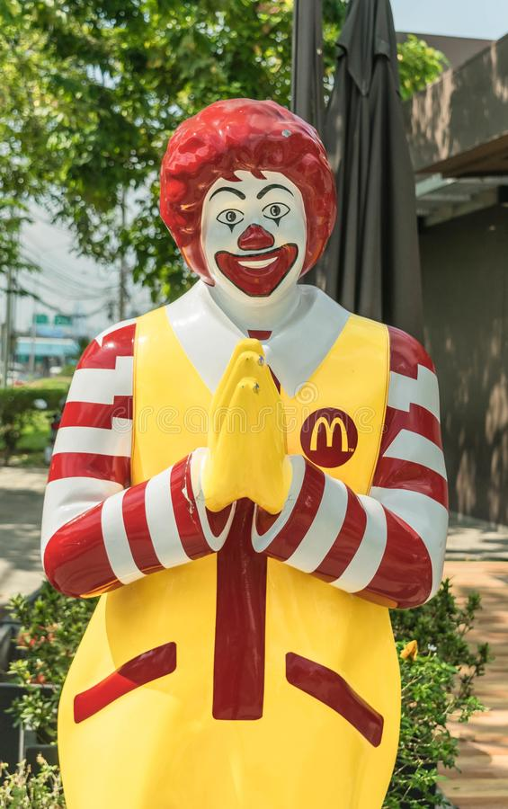 Mascot Symbols Restaurant McDonald `s in Thailand The Statue poses Thai respect style or Wai royalty free stock photo