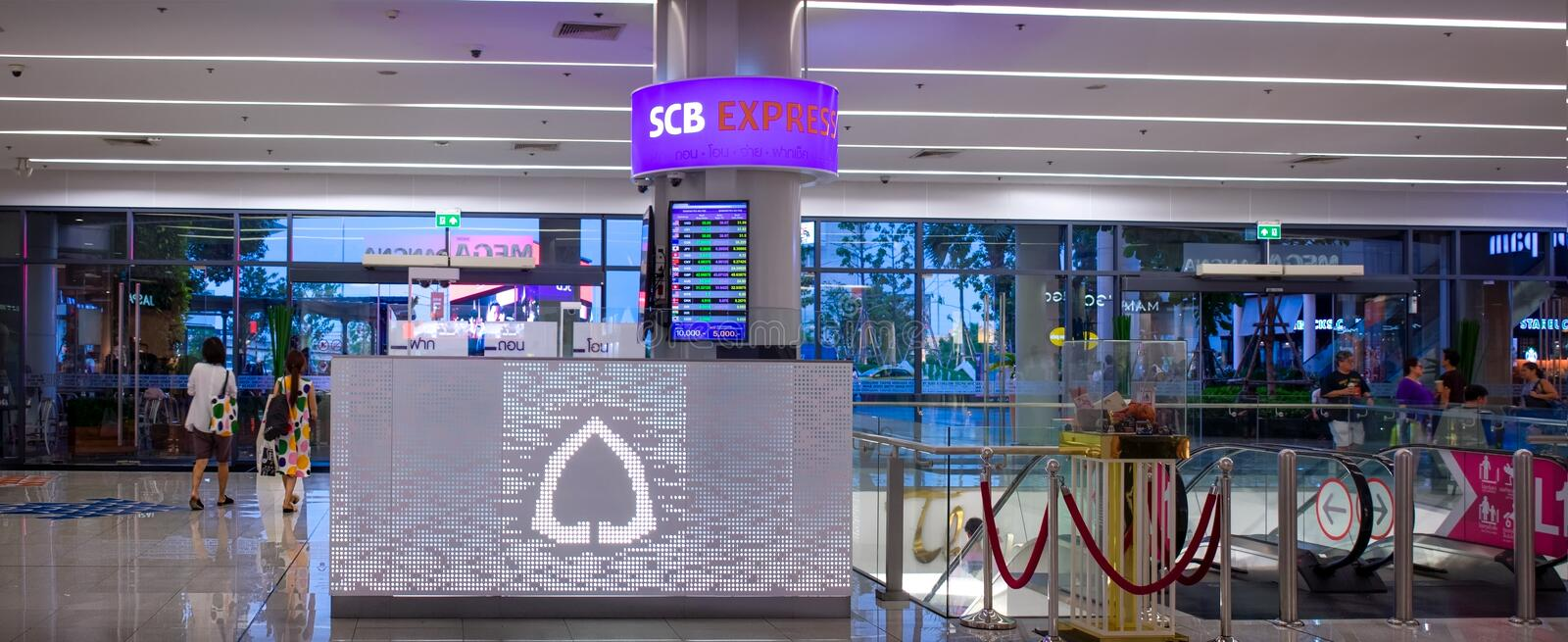 BANGKOK, THAILAND - APRIL 22: Siam Commercial Bank provides currency exchange services from a booth in Mega Bangna shopping mall stock photography