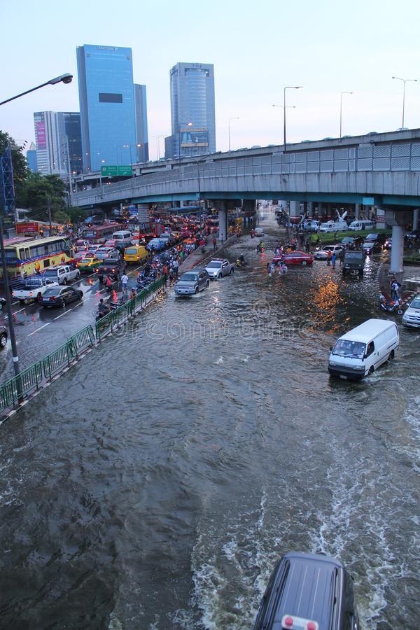 Bangkok, Thailand - April 11 2011 : thai flood hits ladprao Intersection of Thailand the flood after the heaviest monsoon rain in. 20 years. Flooding in Bangkok stock photography