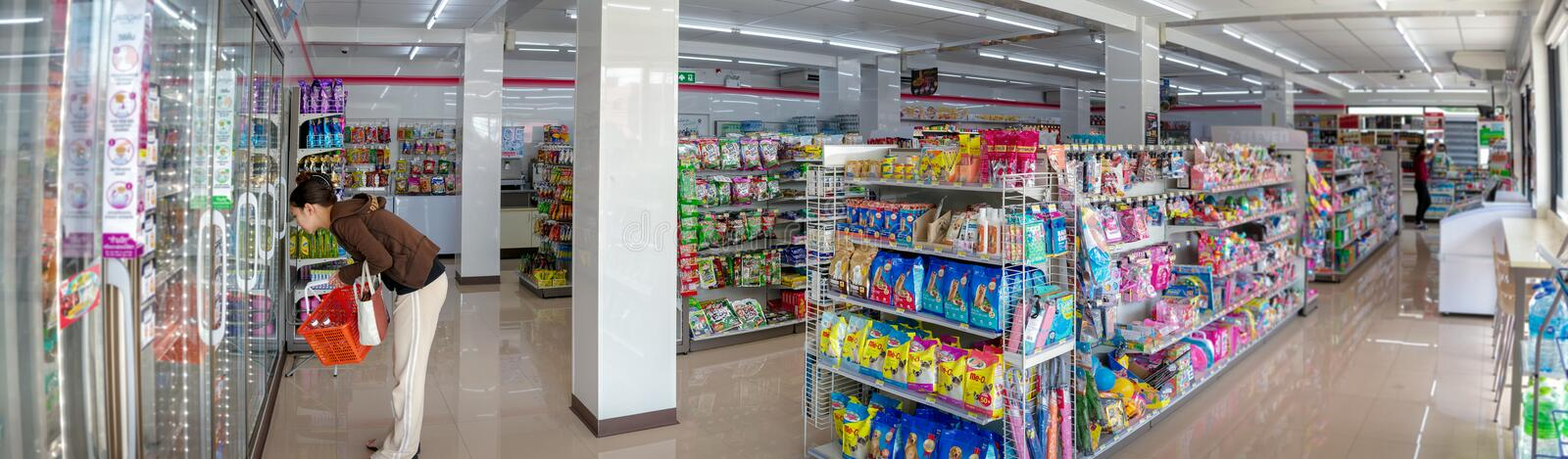 BANGKOK, THAILAND - APRIL 24: Unnamed female customer shops in the newly opened 7-Eleven convenient store in Chao Sua 69 plaza in royalty free stock photography