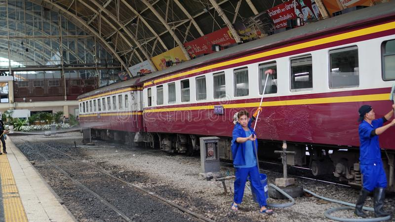 Bangkok, Thailand - Aug 19 : Workers cleaning train at Hualampong, Bangkok railway station. Bangkok,  -  19 : workers cleaning train at hualampong, bangkok stock photos
