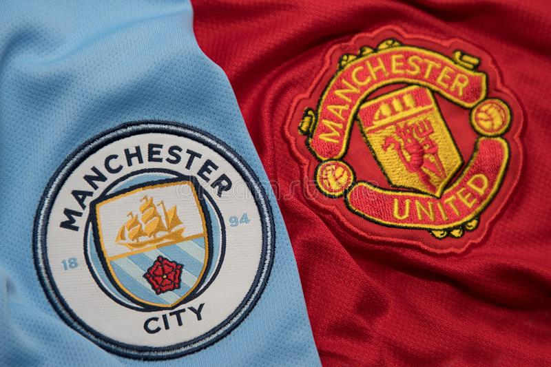 BANGKOK, THAILAND - AUGUST 5: Logo of Manchester City andManchester United Football Club on the Jersey on August 5,2017 in. Bangkok Thailand royalty free stock images