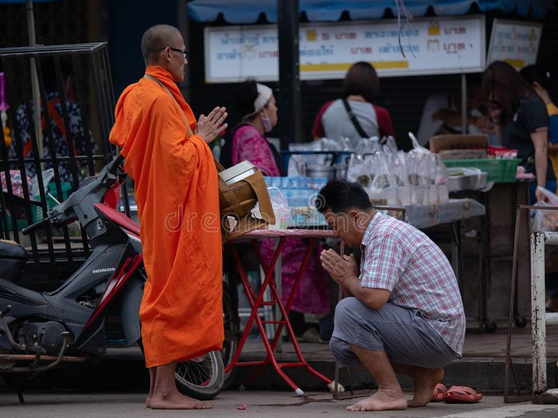 Bangkok, Thailand - August 16, 2017: monks walking on the street to collect alms and offerings in the morning for alms gathering stock images