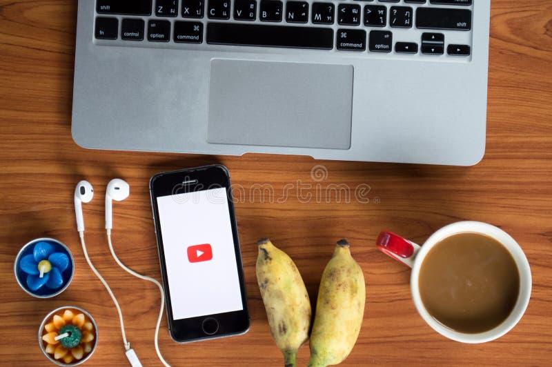 Bangkok Thailand 6 August 2016 play youtube on iphone with mackbook. stock photo
