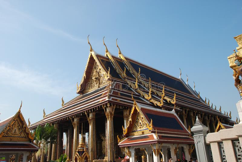 Bangkok, Thailand - 12.25.2012: Beautiful multi-colored sculptures and monuments in a Buddhist temple stock photography
