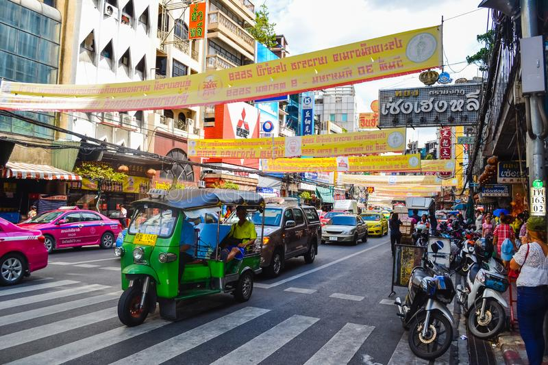 Bangkok, Thailand - november 15, 2016: busy rush hour city street with lots of signs and banners in the background, chinatown, tuk royalty free stock image