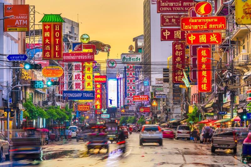 Bangkok, Thailand Chinatown. BANGKOK, THAILAND - SEPTEMBER 27, 2015: Traffic on Yaowarat Road passes below lit signs in the Chinatown district at dusk stock images