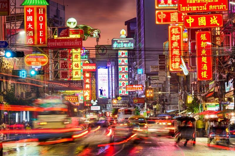 Bangkok Thailand Chinatown. BANGKOK, THAILAND - SEPTEMBER 27, 2015: Traffic on Yaowarat Road passes below lit signs in the Chinatown district at dusk