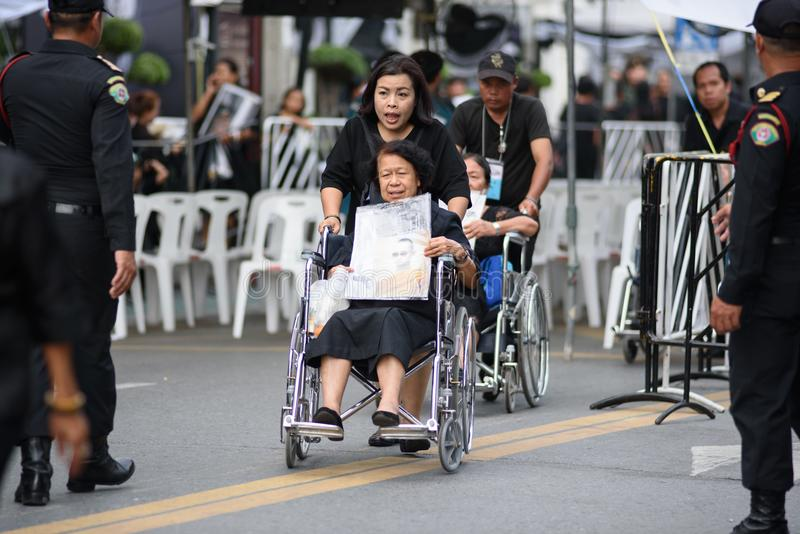 Thai people grieve over the demise of King Rama9. BANGKOK,THAILAND-DEC5,2016:The death of Thai beloved king rama9 on 13 October,2016 makes the people being in stock photography