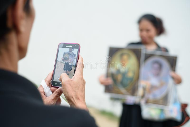 Thai people grieve over the demise of King Rama9. BANGKOK,THAILAND-DEC5,2016:The death of Thai beloved king rama9 on 13 October,2016 makes the people being in stock images