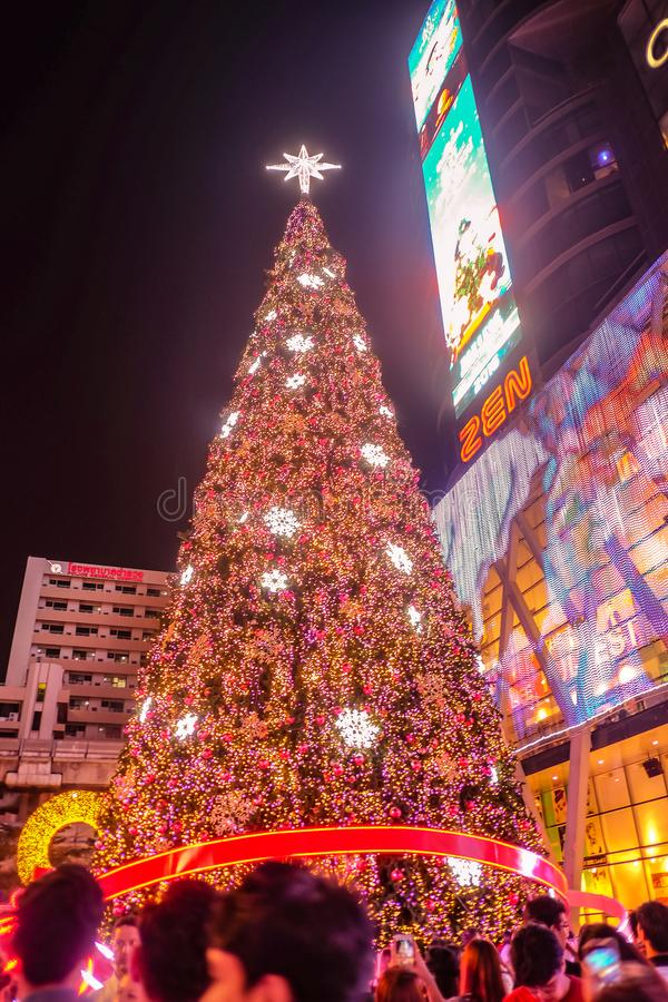Christmas Tree in front of Central world deparment store with Tourist walking in Christmas eve day.bangkok City thailand. Bangkok/Thailand - 24 December 2015 stock photography